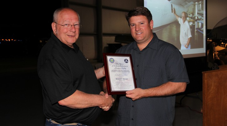 Molczan (left) receives FAA award from Twin Commander Aircraft President Matt Isley