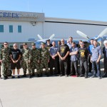 Technicians from Eagle Creek Aviation Services and members of the Colombian Army pose with the third Grand Renaissance that Eagle Creek has done for the Colombians.