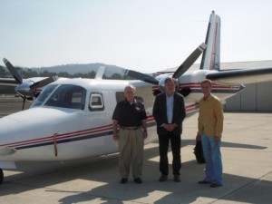 (L-R) Jerry Hammes, Jerry Mowbray, and Mowbray's cousin John Hammes with Mowbray's 680F(P).  As a young man Jerry Hammes flew with his father, Romy Hammes, in the Commander 520 beginning in 1953.