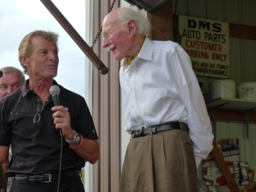 Aerobatic great Sean D. Tucker (left) showers Bob Hoover with praise at a recent gathering.