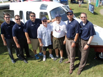 Eagle Creek delivered the sixth G950 Twin Commander at EAA's AirVenture 2015 in Oshkosh, Wisconsin. (L-R) Garmin's Dan Lind, Creighton Scarpone and Jim Laster; Eagle Creek's Matt Hagans; 690B owner Abe Abuchowski; and Garmin's Phil Straub and Jim Alpiser.