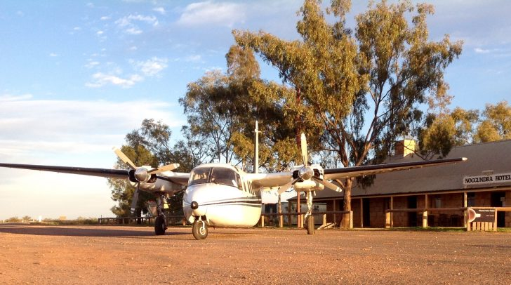 Heron Airlines Twin Commander outside Nocundra pub in central Australia