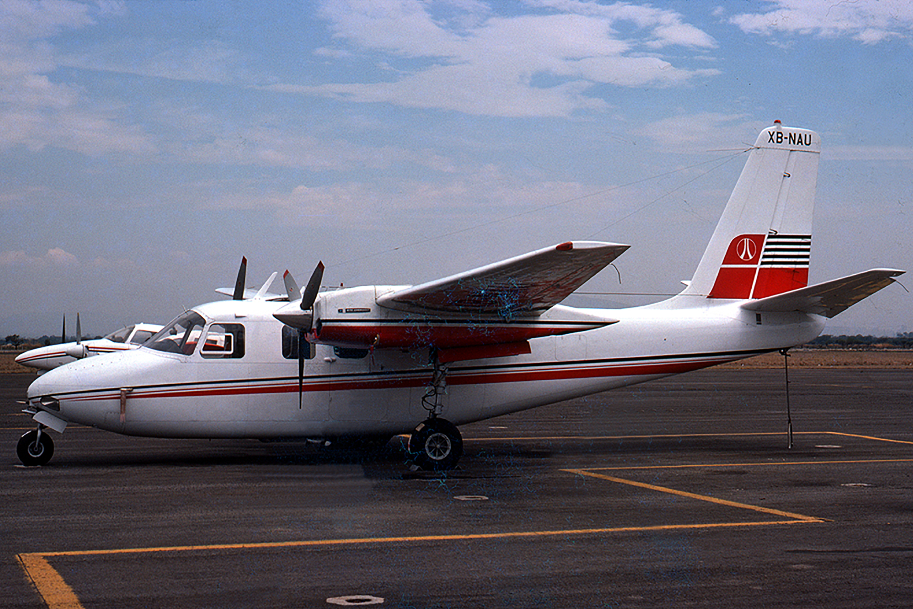 XB-NAU: Scanned from a slide taken on June 12, 1976 at Guadalajara, Jalisco, Mexico, by an unknown photographer, XB-NAU is serial number 1668-17 and was exported as a new aircraft in February 1967 for Cementos Mexicanos SAdeCV. of Monterrey, Nuevo Leon. At the time the slide was taken it was owned by Belloc Carlos Zambrano, of Guadalajara. It has been subsequently re-registered in Mexico, first as XA-TMW in January 1999, then as XB-KSK in April 2008. It is still current there.